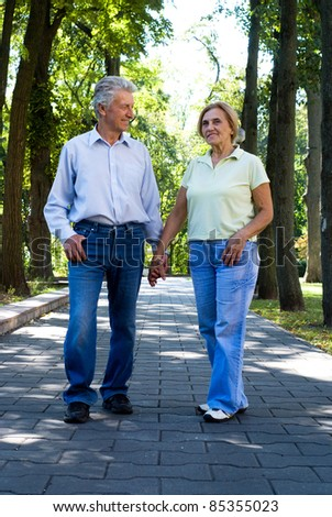portrait of a cute old couple at park