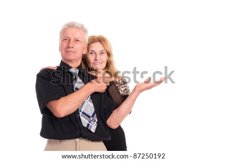 portrait of a cute old couple on a white