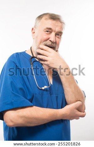 portrait of a cute old doctor in blue robe