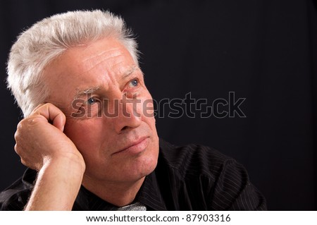 portrait of a cute old man on a black