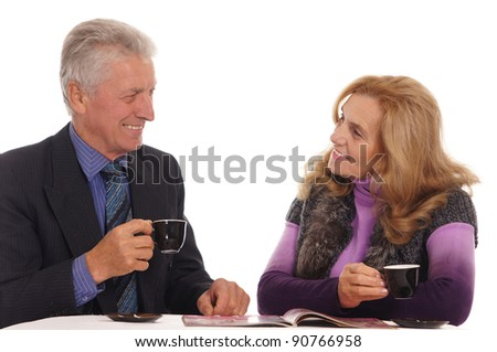 portrait of a cute old people at table