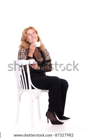 portrait of a cute old woman at chair