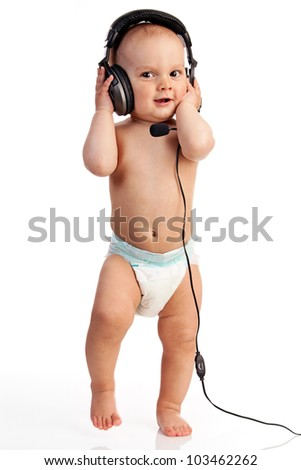 Portrait of a cute one-year old boy wearing a headset against white background - stock photo