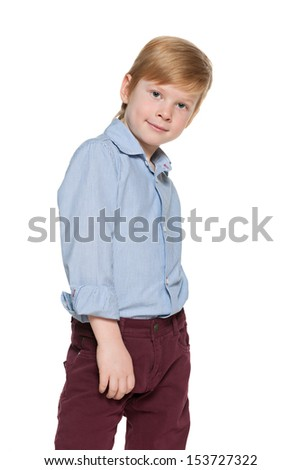 Portrait of a cute red-haired boy on the white background