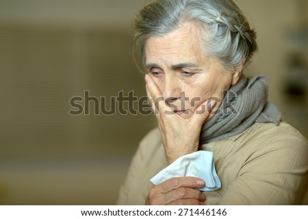 Portrait of a cute sad aged woman - stock photo