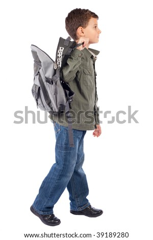 Portrait of a cute schoolboy with backpack isolated on white background