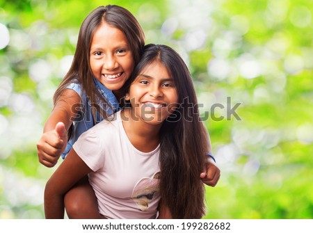 portrait of a cute sisters having fun - stock photo