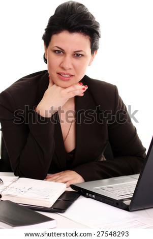 Portrait of a cute smiling businesswoman working on a laptop - stock photo
