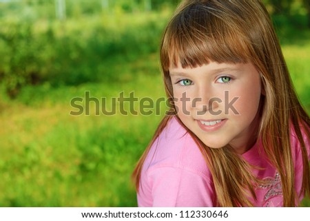 Portrait of a cute smiling girl outdoor.