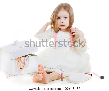 portrait of a cute smiling girl with a box with jewelry - stock photo