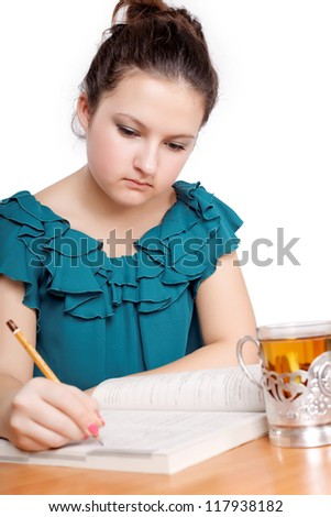 Portrait of a cute student studying isolated