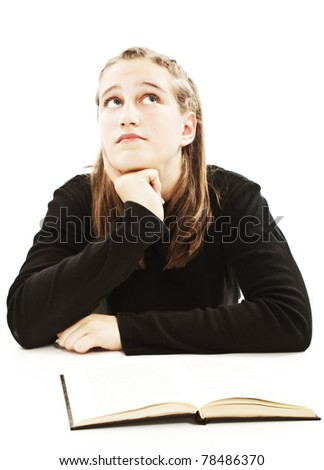 Portrait of a cute teenage girl at her desk. All on white background. - stock photo