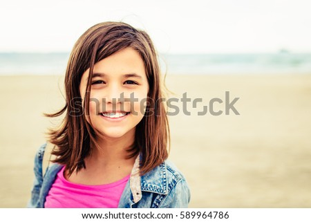portrait of a cute teenage girl at the beach