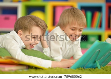 portrait of a cute two boys reading