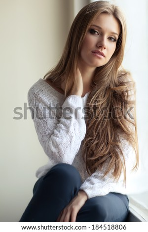 Portrait of a cute woman - stock photo