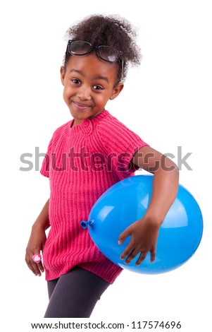 Portrait of a cute young African American girl holding a blue balloon,isolated on white background