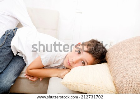 Portrait of a cute young boy at home  - stock photo