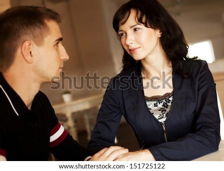 Portrait of a cute young couple in love sitting together at home