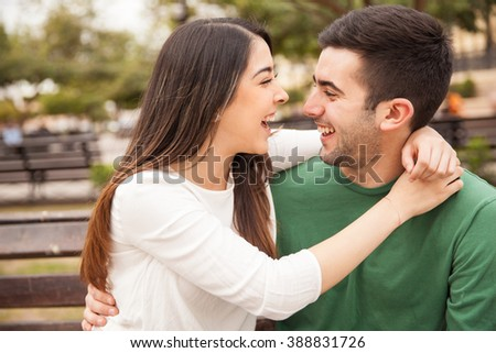 Portrait of a cute young couple laughing together and having a good time
