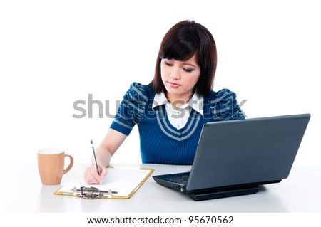 Portrait of a cute young female with laptop and writing on clipboard, isolated on white background.
