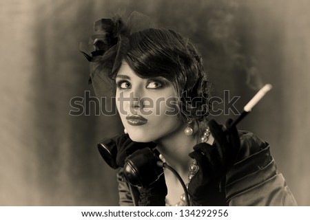portrait of a cute young woman in retro style - stock photo