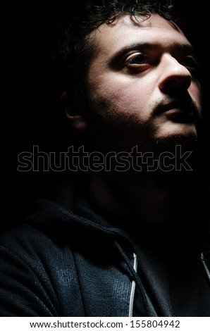 Portrait of a dangerous man with an intimidating expression - stock photo