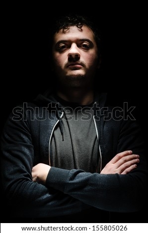 Portrait of a dangerous man with an intimidating expression