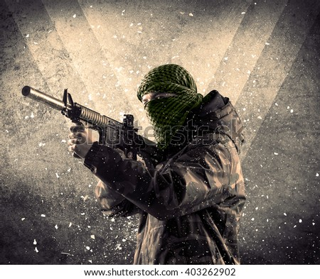 Portrait of a dangerous masked armed soldier with grungy light background  - stock photo