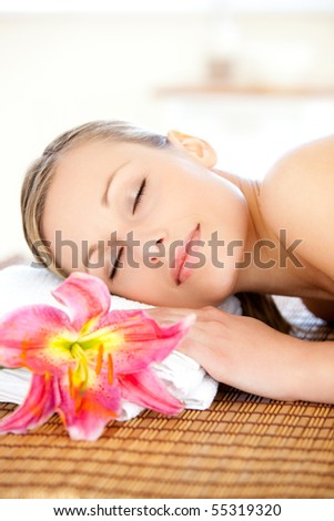 Portrait of a delighted woman having a massage in a spa
