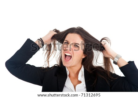 Portrait of a desperate young businesswoman pulling her hair - stock photo