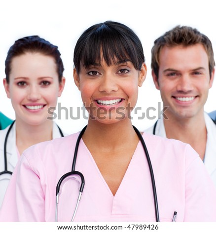 Portrait of a doctor and her medical team against a white background - stock photo