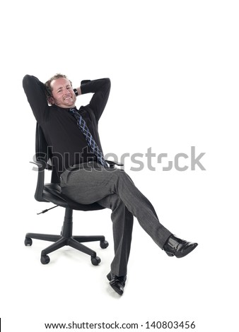 Portrait of a doctor relaxing on chair against white background