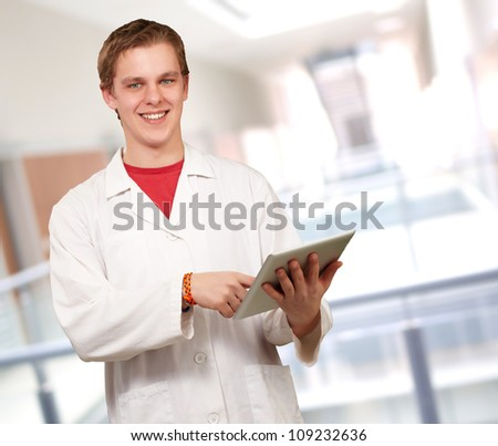 Portrait of a doctor using a tablet, outdoor - stock photo
