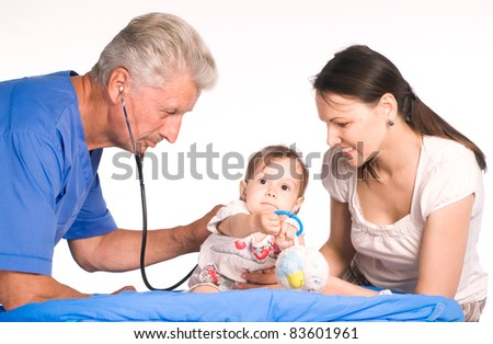 portrait of a doctor with a family - stock photo