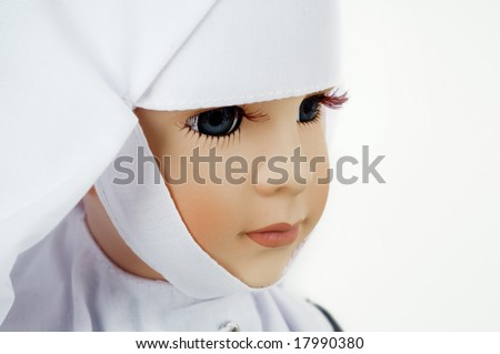 Portrait of a doll of a nun