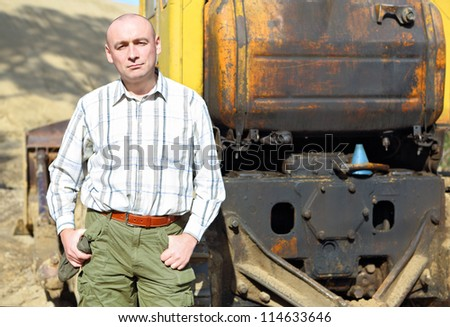 Portrait of a driver of construction equipment