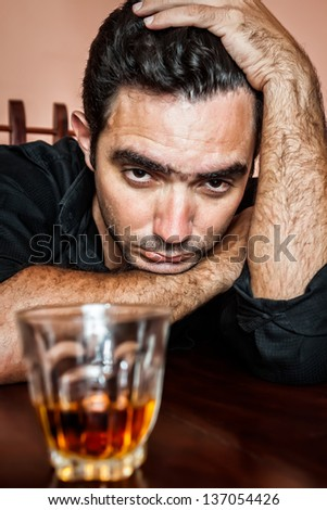 Portrait of a drunk and depressed hispanic man - stock photo