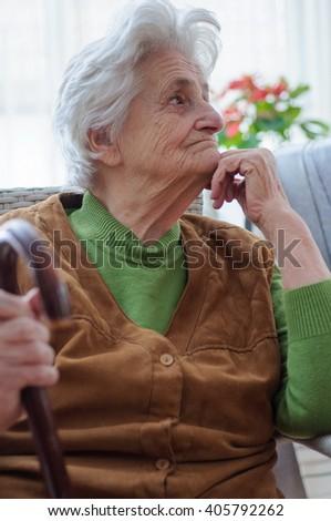 Portrait of a elderly woman - stock photo