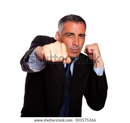 Portrait of a elegant business man on black suit boxing against white background - stock photo