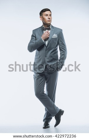 Portrait of a elegant handsome business man on white background  - stock photo