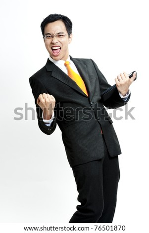 Portrait of a energetic young businessman enjoying success against white - Isolated - stock photo