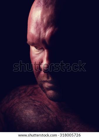 Portrait of a evil man - stock photo