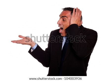 Portrait of a excited hispanic businessman screaming with extended right hand on isolated background - stock photo