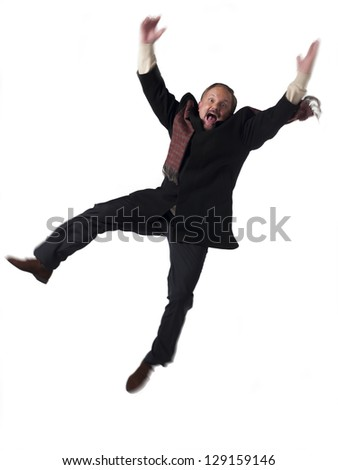 Portrait of a exited mature businessman jumping over white background