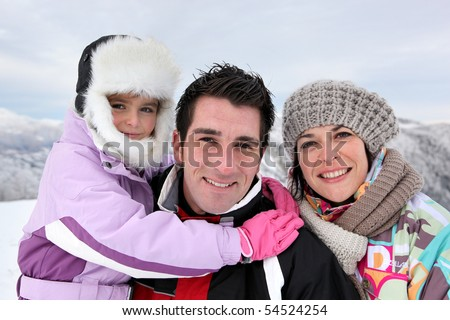 Portrait of a family at the snow - stock photo
