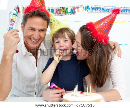 Portrait of a family celebrating little boy's birthday at home - stock photo