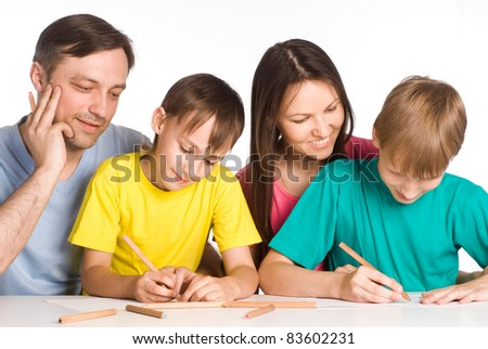 portrait of a family drawing at table