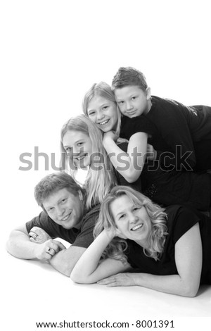 Portrait of a family in a fun pose. - stock photo