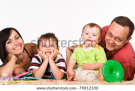 portrait of a  family lying on carpet