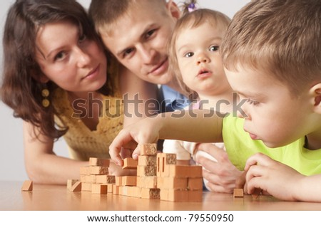 portrait of a family of a four playing